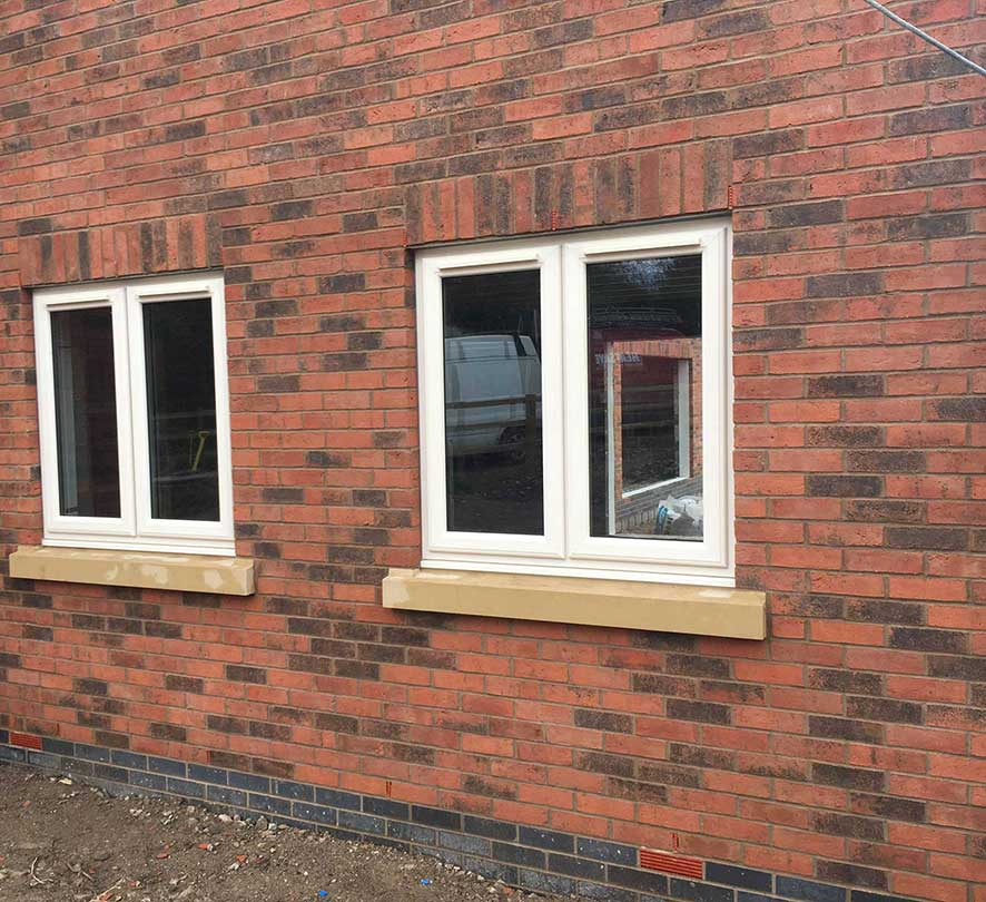 two double white framed windows